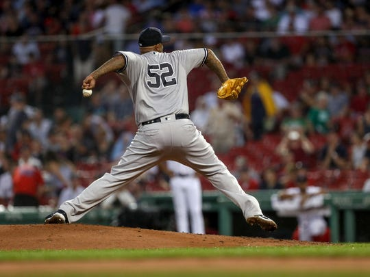 Aug 2, 2018; Boston, MA, USA; New York Yankees starting pitcher CC Sabathia (52) throws a pitch during the second inning against the Boston Red Sox at Fenway Park.