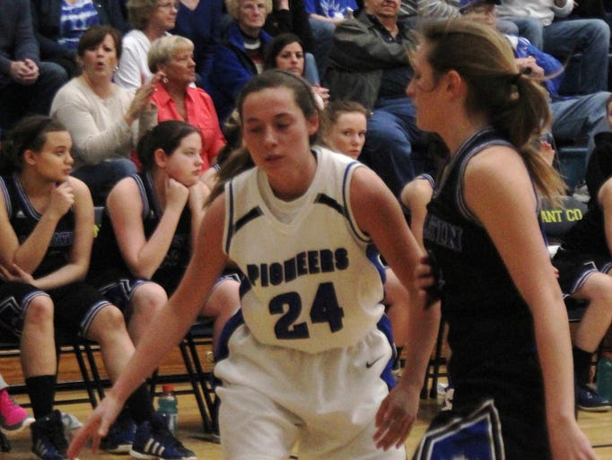Simon Kenton senior Christina Cook (24) prepares to drive to the hoop. Simon Kenton defeated Gallatin County 78-61 in the Eighth Region semifinals in girls basketball March 8, 2014 at Grant County High School.