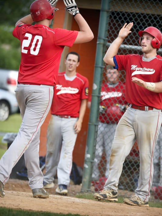 Myerstown's Brett Bawiec (20) goes to high-five teammate Cody Horst after coming around to score during the team's 6-1 win against Campbelltown on Tuesday.