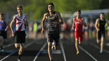 Ashwaubenon's Jose Guzman races towards the finish line to win the 400-meter dash during last year's WIAA Division 1 sectional track and field meet at Bay Port High School in Suamico. Guzman is aiming to repeat as the D1 state champion this season.