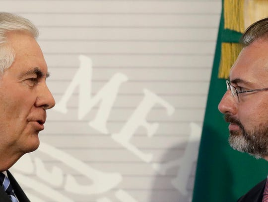 U.S. Secretary of State Rex Tillerson, left, shakes