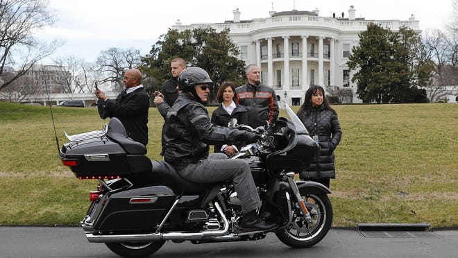 FILE - In this Thursday, Feb. 1, 2017 file photo, Harley Davidson President and CEO Matthew S. Levatich rides his motorcycle onto the South Lawn of the White House in Washington before a meeting with President Donald Trump and Vice President Mike Pence. Harley-Davidson CEO Matthew Levatich is leaving the struggling motorcycle maker. The Milwaukee company announced Friday, Feb. 28, 2020 that he'll leave his post and seat on the Harley's board of directors. (AP Photo/Pablo Martinez Monsivais, File)