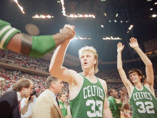 Boston Celtics forward Larry Bird (33) gets congratulated as teammate Kevin McHale (32) goes up with his arms in victory over the Houston Rockets in game four by score of 106-103, Tuesday, June 4, 1986, Houston, Tex.