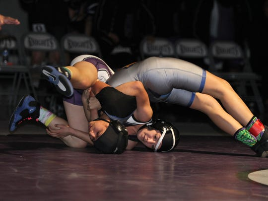 Shadow Hills High's Scarlett Garabilto wrestles Brawley High's Sasha Barra during the first-ever girls-only dual wrestling meet held in the valley and at Shadow Hills High School in Indio on Thursday, January 21, 2016.