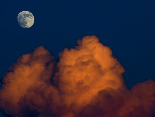 The moon rises obove the clouds at sunset in Centerville,