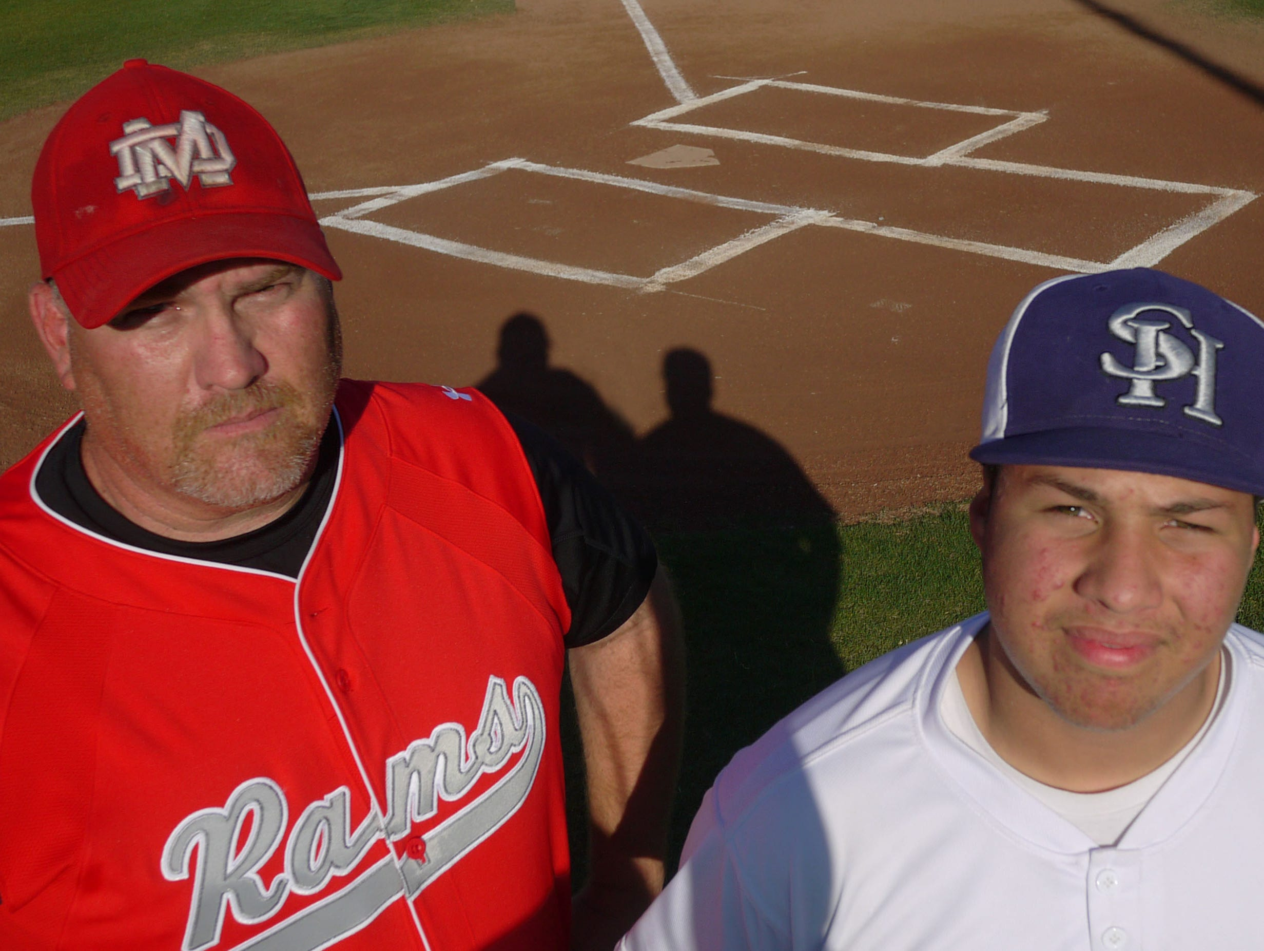 Desert Mirage baseball coach Jason Beck stands with his son Darian Beck, who played for the Shadow Hills High School baseball team. The elder Beck will now coach the Knights next season.