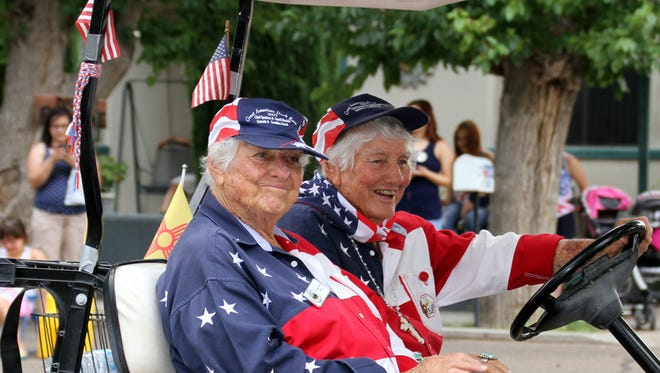 The Kretek Twins, from left, Gertrude and Geraldine, ride in the Fourth of July Parade. The Deming Fourth of July Celebration Committee is now accepting parade entries and vendor applications.