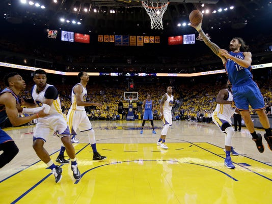 Oklahoma City Thunder's Steven Adams (12) drives to the basket against the Golden State Warriors during the first half in Game 1 of the NBA basketball Western Conference finals Monday, May 16, 2016, in Oakland, Calif. (AP Photo/Marcio Jose Sanchez)