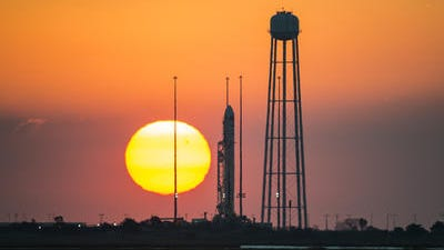 The Orbital Sciences Corp. Antares rocket, with the Cygnus spacecraft onboard, on launch Pad-0A during sunrise, Sunday, Oct. 26, 2014, at NASA's Wallops Flight Facility in Virginia. The rocket failed shortly after liftoff on Oct. 28.