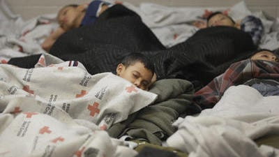 Young detainees asleep in a holding cell at a Customs and Border Protection processing facility in Brownsville,Texas, last month.