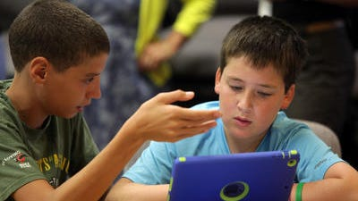 From left, Austin Vazquez and Ben Schoenberg go over ideas for creating a self-sustaining structure during orientation at the P-TECH school at Rockland BOCES' West Nyack campus.