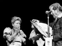 Fan favorite Minnie Pearl, left, is surprises by host Roy Acuff with a silver tray presented to her for 35 years of Grand Ole Opry membership during the Opry's third annual homecoming show at the Opry House March 20, 1976.