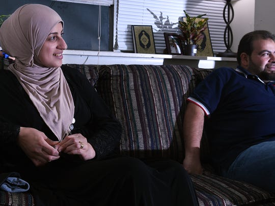 Syrian refugees Khuloud Hamzeh, left, and Fahed Nakshou share their story about their journey from Syria to Jordan to America.