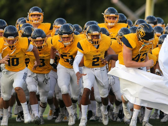 The Moeller Crusaders take the field before the high