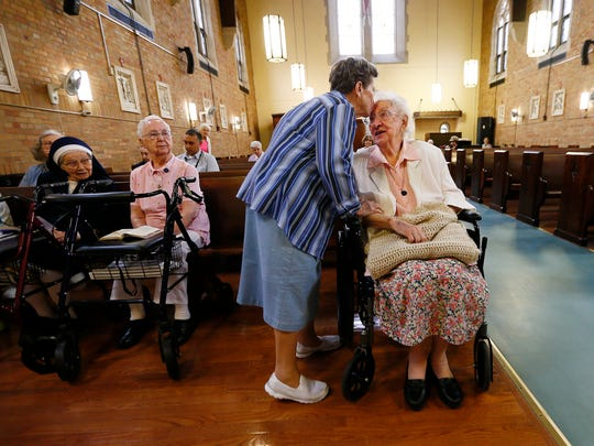 Sister Regina Palkovics gets a kiss from a fellow Sister during morning mass. Sister Regina turned 105 today at The Villa at Florham Park. June 7, 2018. Florham Park, NJ