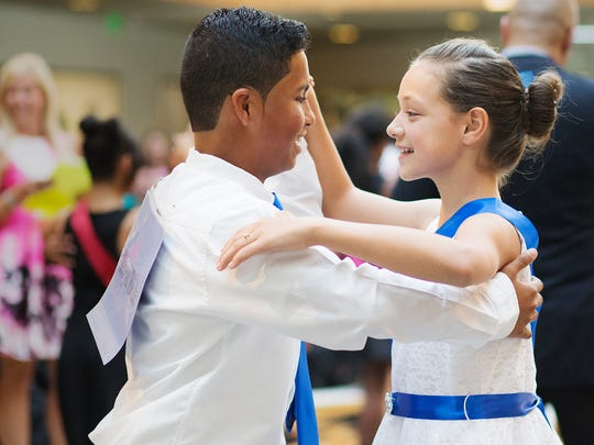 "Dr. Carrie D. Robinson Littleton Elementary school students Julian Domenech and Anayi Delgado dance Saturday in the ""Colors of the Rainbow Team Match,"" finale for the Foundation for Lee County Schools' Dancing Classrooms program at the Miromar Design Center in Estero."