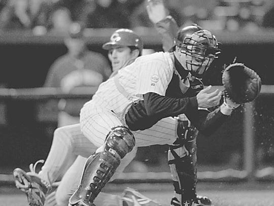 From 1996, Rockies catcher Jayhawk Owens waits for