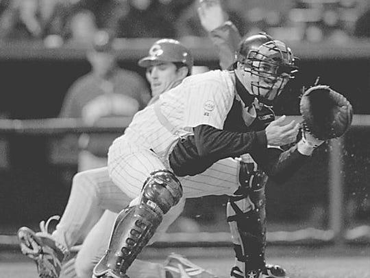 From 1996, Rockies catcher Jayhawk Owens waits for
