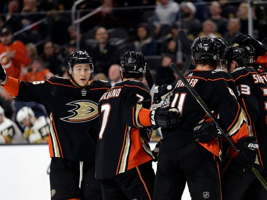 The Anaheim Ducks celebrate following a goal during the first period of an NHL hockey game against the Vegas Golden Knights Monday, Feb. 19, 2018, in Las Vegas. (AP Photo/Isaac Brekken)