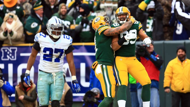 Green Bay Packers tight end Richard Rodgers (89) celebrates with tight end Andrew Quarless (81) after scoring a touchdown against Dallas Cowboys free safety J.J. Wilcox (27) in the fourth quarter in the 2014 NFC Divisional playoff football game at Lambeau Field.