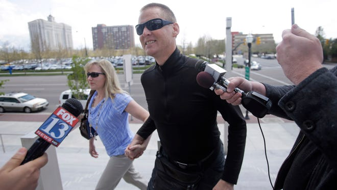 """Dell """"Super Dell"""" Schanze arrives for a court appearance at the federal courthouse Thursday, April 9, 2015, in Salt Lake City. A plea deal for the former TV pitchman in Utah accused of kicking a barn owl in flight while riding a motorized paraglider fell through Thursday when he refused to admit to the crime. (AP Photo/Rick Bowmer)"""