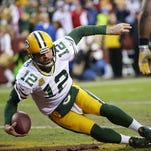 Green Bay Packers quarterback Aaron Rodgers is sacked in the end zone for a Washington safety in the first quarter of an NFC wild-card playoff game Jan. 10 in Landover, Maryland.