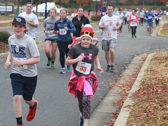 A few young runners head to the finish at the Indian