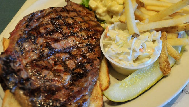 A ribeye steak sandwich prepared Monday afternoon at The Mint Cafe in downtown Wausau.