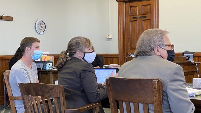 Matthew H. Little (left) sits with attorneys Andrea Whitaker and William Whitaker during a hearing Thursday in Carroll County Common Pleas Court. Little faces a count of involuntary manslaughter and other charges in the drug overdose death of a 14-year-old boy in the spring of 2019.