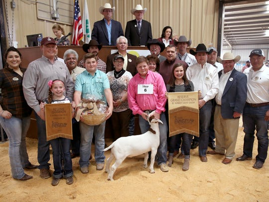 Mason Hutto, Schleicher Co. 4-H, sold the reserve grand champion market goat for $15,500. Pictured are Carla Collier, Lone Star Beef; Davis Hutto; Ella Rae; Raymond Meza, Twin Mountain Fence; Cade Thomas; Cooper Wade, City Lumber; Keith Grogan, Grogan Farm and Ranch; Dawn Foster, No Step Ranch; Hutto; Greg Hoelscher, H-E-B; Mike Martin, Goode Construction; Sean Carter, Gandy Ink; Tommy Neal, Edward Jones; Bubba Davis, West Texas Steel; Todd Price, Jim Bass Cars and Trucks; and John Castillo; GA Auto Glass.