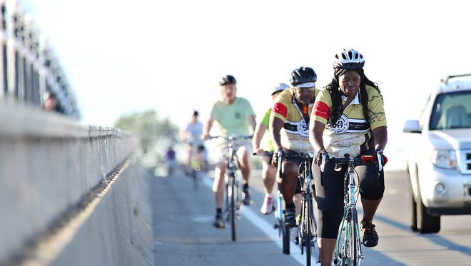 Cassandra Spratling, right, rides with other cyclists as they train for the Wayne State University's Barodeur, the first annual cycling event to raise money for scholarships, on Belle Isle in Detroit on Wednesday, Aug. 12, 2015.