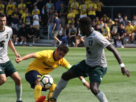 Michigan's Ivo Cerda tries to steal the ball from Michigan