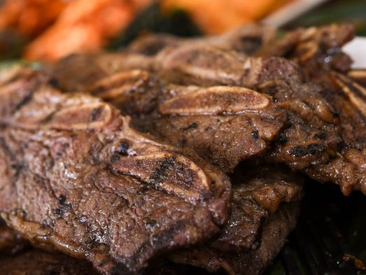 Beef short ribs, marinated for four days, grilled over