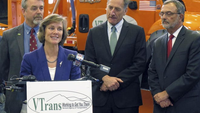 Incoming Vermont Transportation Secretary Sue Minter speaks Tuesday Nov. 18, 2014 in Berlin, after Gov. Peter Shumlin, center, announced Minter would replace retiring Transportation Secretary Brian Searles, right. At left, incoming deputy secretary Chris Cole looks on.