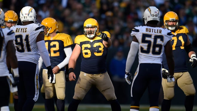 Green Bay Packers center Corey Linsley (63) points to the defense against the San Diego Chargers at Lambeau Field.