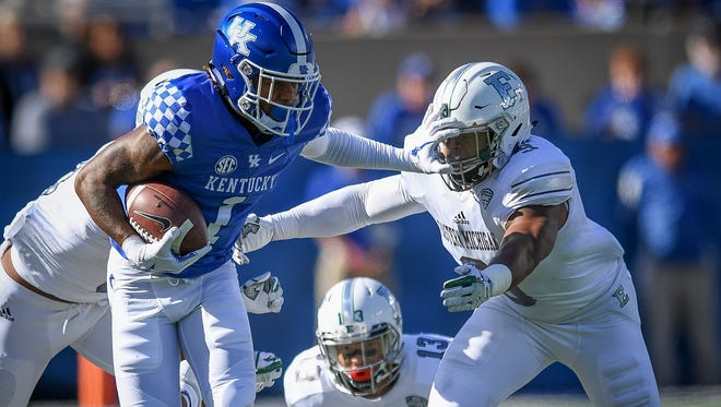 Kentucky Wildcats wide receiver Lynn Bowden Jr. (1) avoids the tackle of Eastern Michigan Eagles linebacker Ike Spearman (9) for five yards during the first half of the game at Kroger Field on the campus of TheUniversity of Kentucky in Lexington, Ky, Saturday, September 30, 2017.