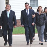 Dover Police Department officer Clp. Thomas Webster walks with his wife Suzanne alongside into Kent County Courthouse on Monday morning. Jury selection started Monday in the second-degree assault trial against Webster.