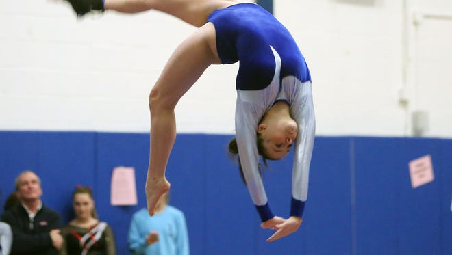 Mahopac's Callie Johanson competes on the balance beam during the Section 1 gymnastics championship at Carmel High School Feb. 14, 2017.
