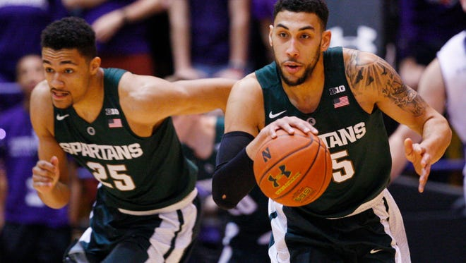 Michigan State guard Denzel Valentine (45) and forward Kenny Goins (25) on a fast break against Northwestern during the first half Thursday in Evanston, Ill.