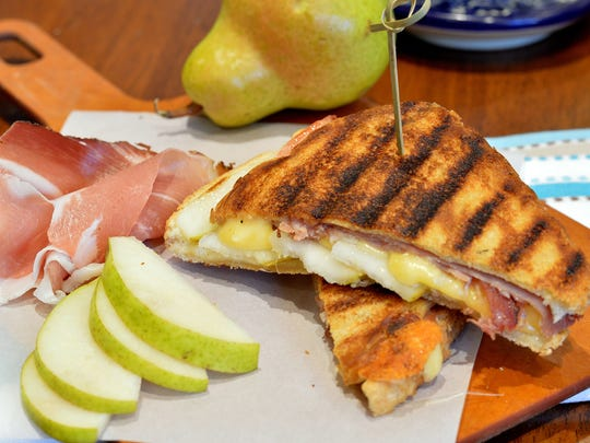 Pears, prosciutto and fontina cheese team up in this five-ingredient panini recipe.