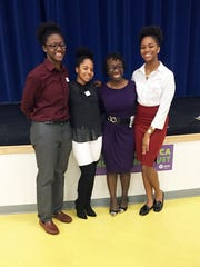 From left, Emily Ansah, Addison Adams, Melissa Lewis and Natalie Nwanekwu organized the hunger awareness banquet for their Global Contexts for Leadership class at Newark Charter.