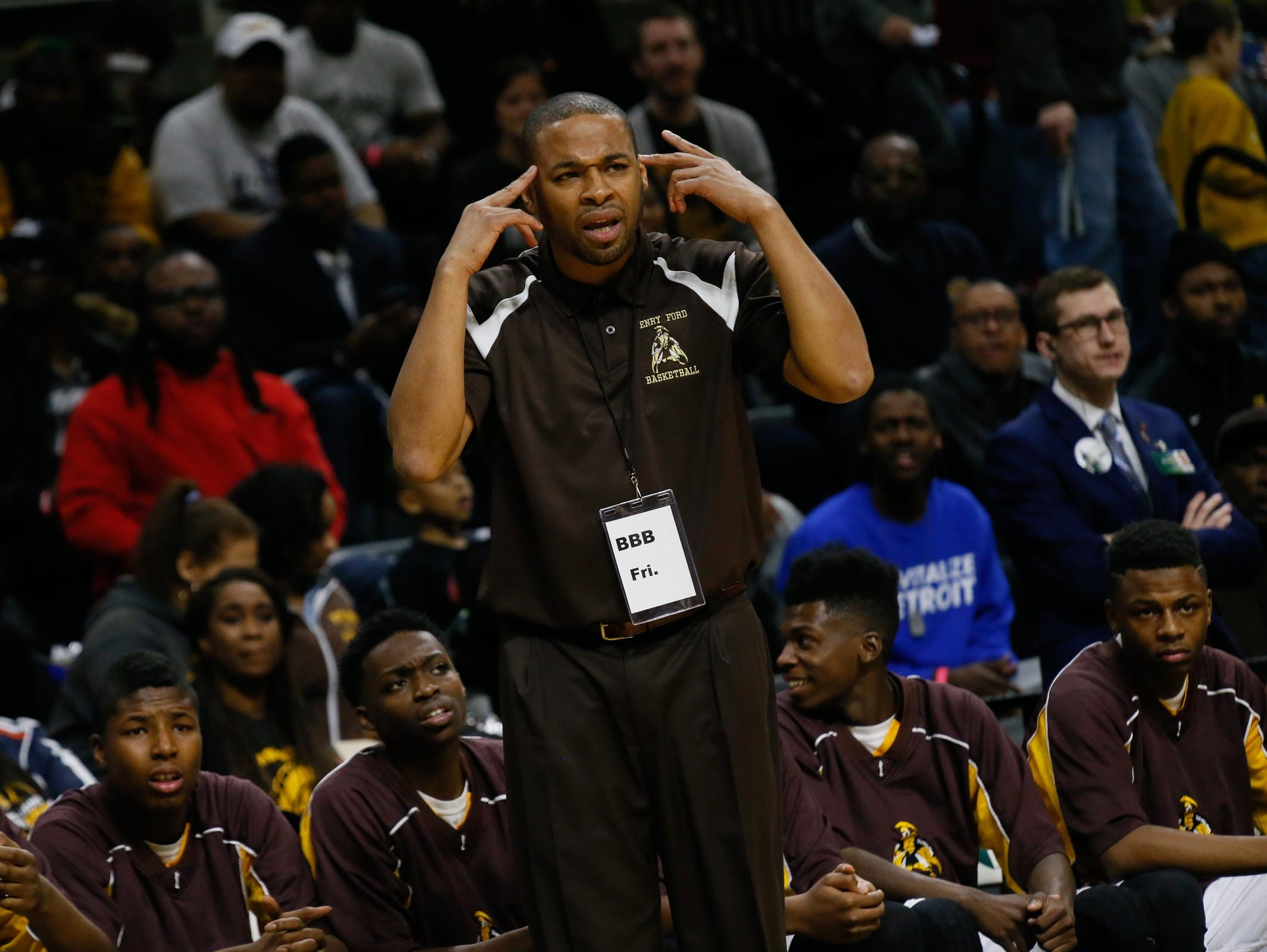 Detroit Henry Ford coach Ken Flowers tells his players to think during their 70-48 semifinal win over Williamston.