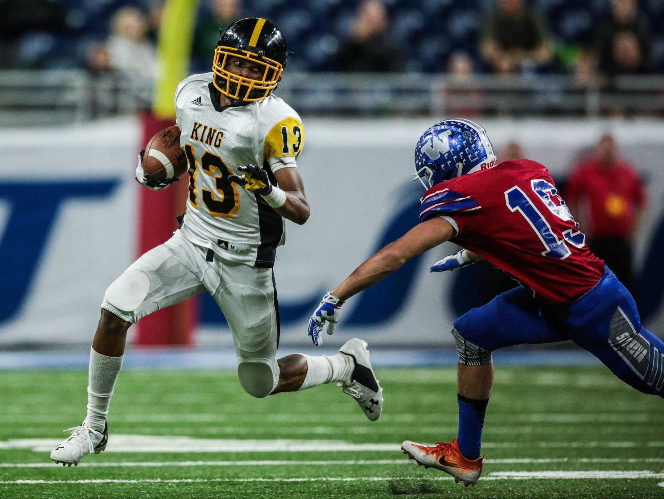Detroit King's Ambry Thomas runs the ball against Walled Lake Western during King's win in the Division 2 state championship game Friday at Ford Field.