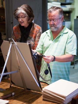 Barbara Kingsolver and her husband, Steven Hopp, at the Vineland Historical and Antiquarian Society's museum research library, reviewed files on Mary Treat.