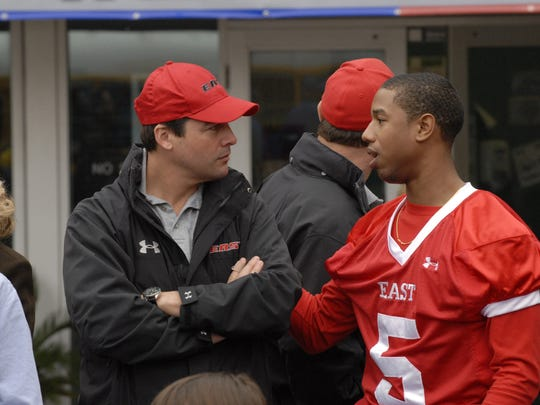 "Kyle Chandler (left) and Michael B. Jordan in ""Friday Night Lights."""