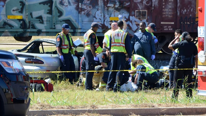 A Chevrolet Camaro was struck by a Kansas City Southern freight train in Jackson Wednesday. The driver died Friday.