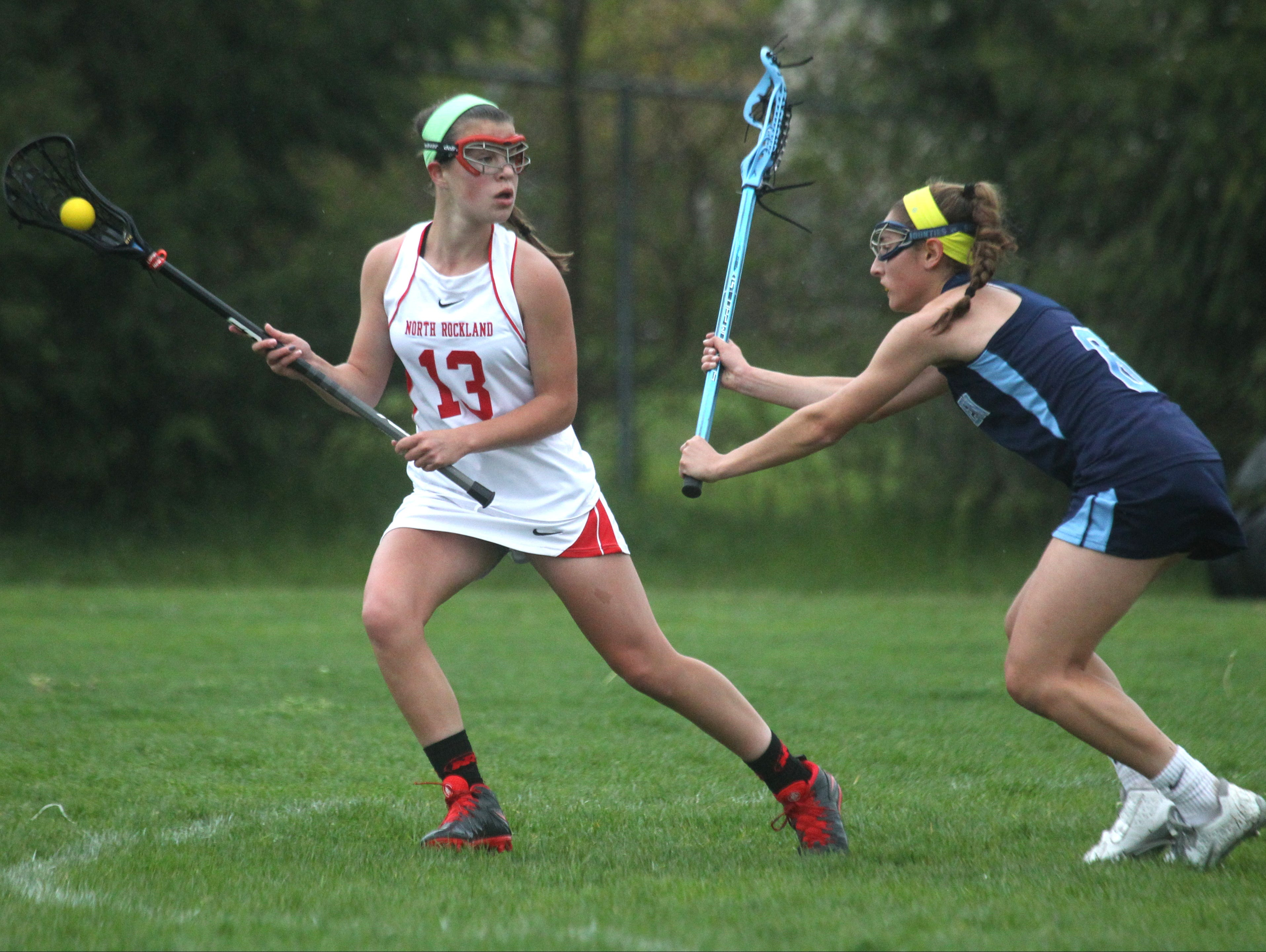North Rockland's Kerri Gutenberger is pressured by Suffern's Hannah Newman during their game at North Rockland May 4, 2016. North Rockland won 8-7.