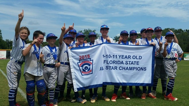 Martin County North 11U Team celebrates their claim on the State Championship, Sunday, July 15.