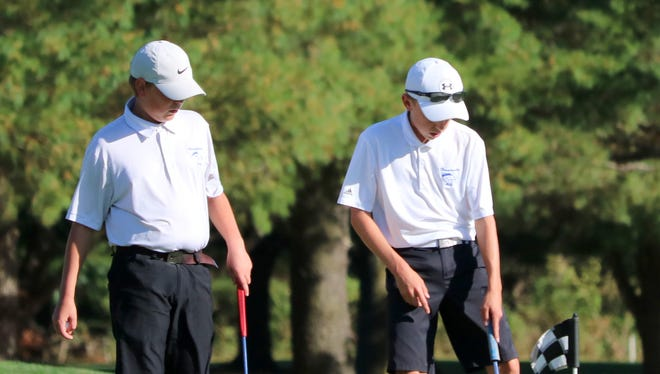 Horseheads golfers Zack Locke, left, and Seth Conway play together Oct. 3 during a home win against Binghamton at Willowcreek Golf Club in Big Flats.