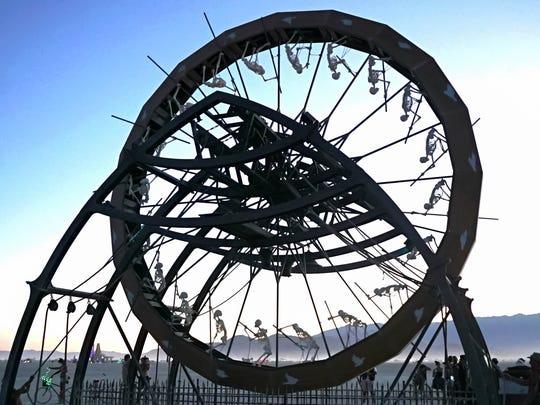 A wheel of skeletons displayed as art at Burning Man.